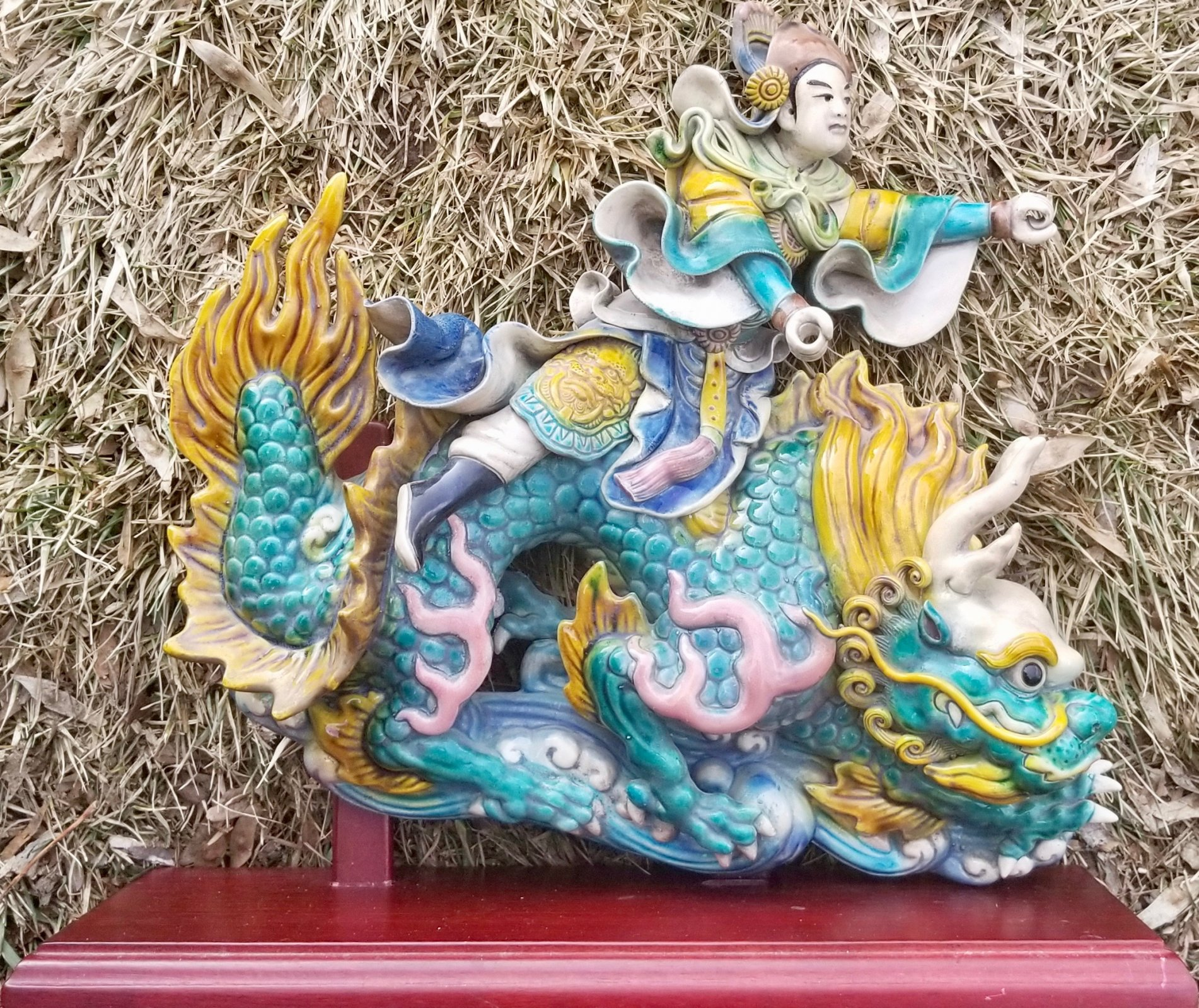 20th century Chinese porcelain roof tile of a man riding a dragon