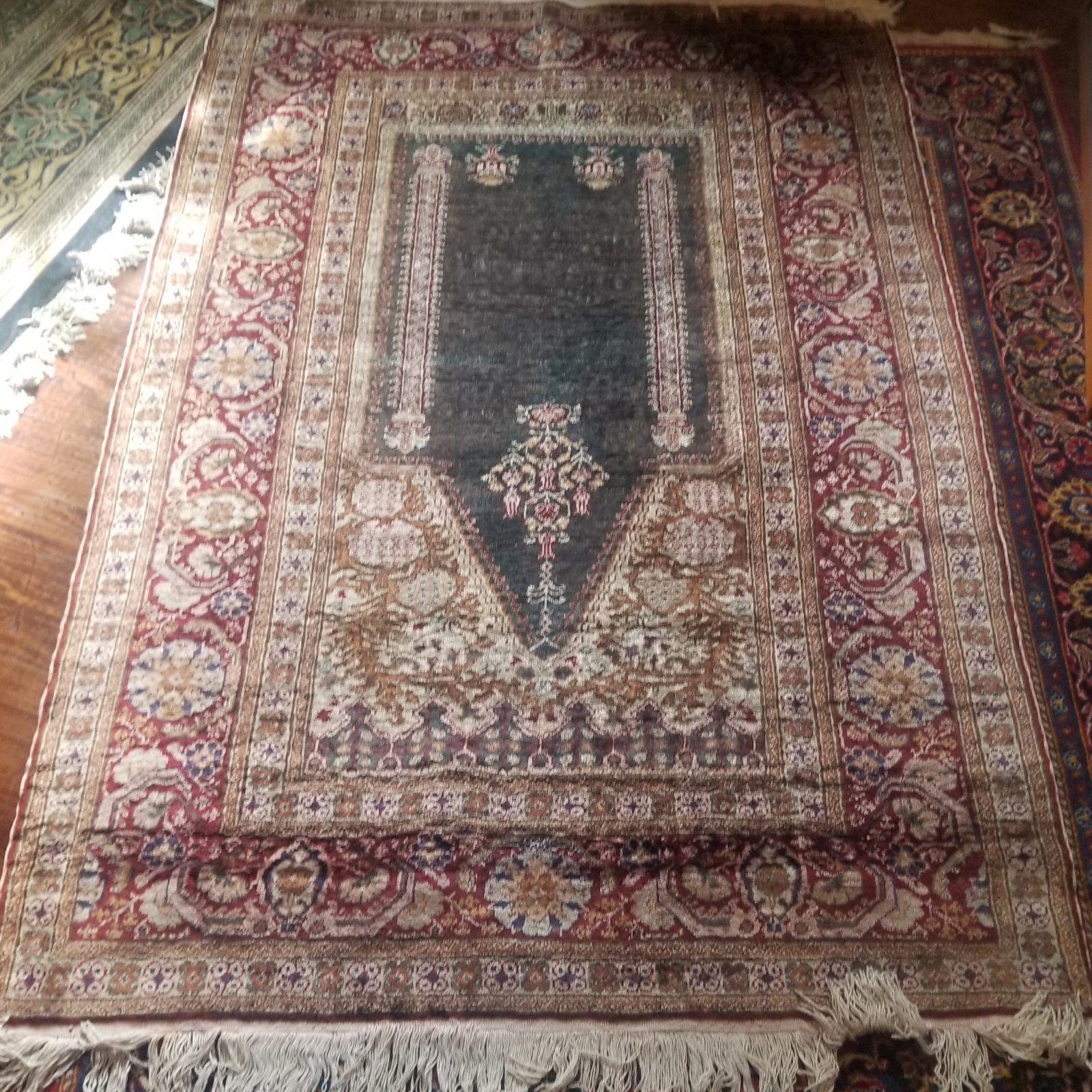 6'6 X 4'1 Turkish mercerized cotton prayer rug Circa 1950-1960 dark green field with dark red and cream borders with accents of gold brown and other colors.   SXY