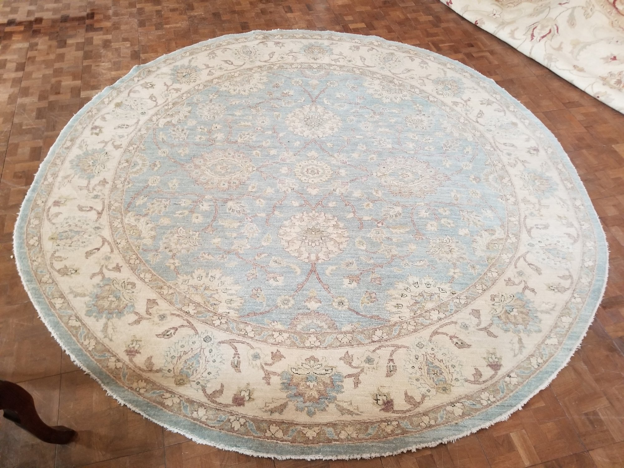 8' X 8'1 Indian made Peshewar design in a light sky blue and cream border and accents   PDTX
