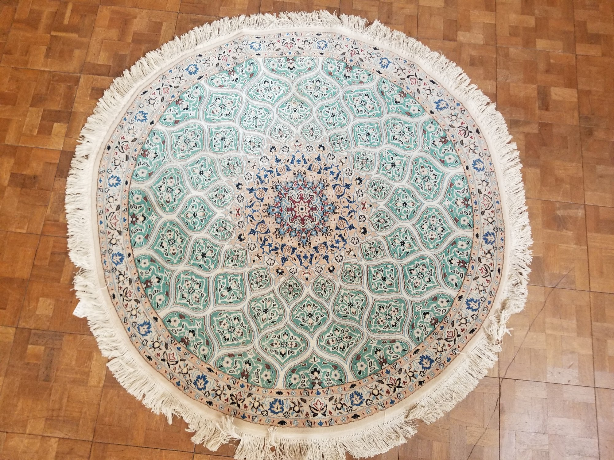 4'9 X 4'9 Persian Nain with a sage green field taupe border and medallion with accents of deep red. blue and ivory    DTX