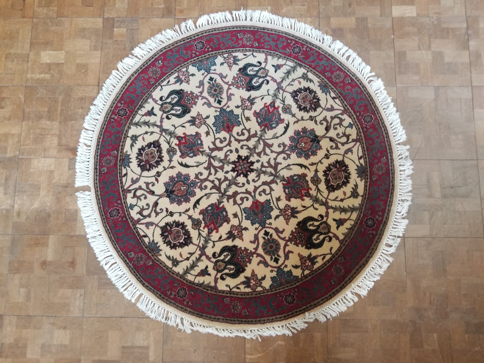 4'5 X 4'5 Indian made Kashan with an Ivory field red border and accents of green blue and other colors throughout   SUT
