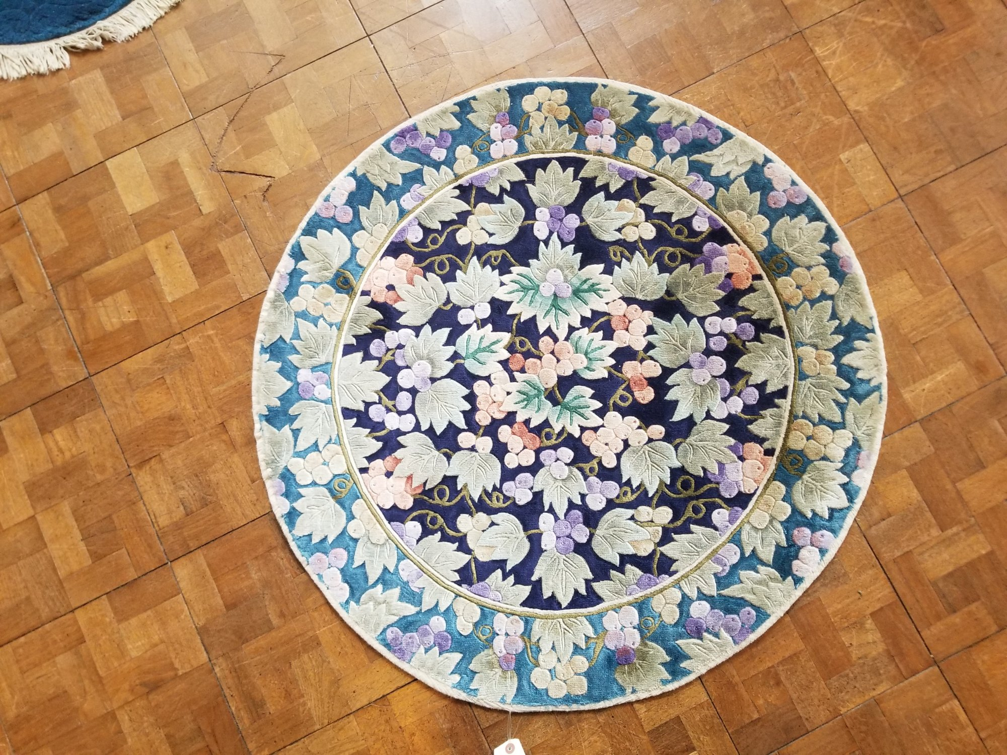 3'1 X 3'1 Chinese wool; and silk carved multi color rug with carved flower motif