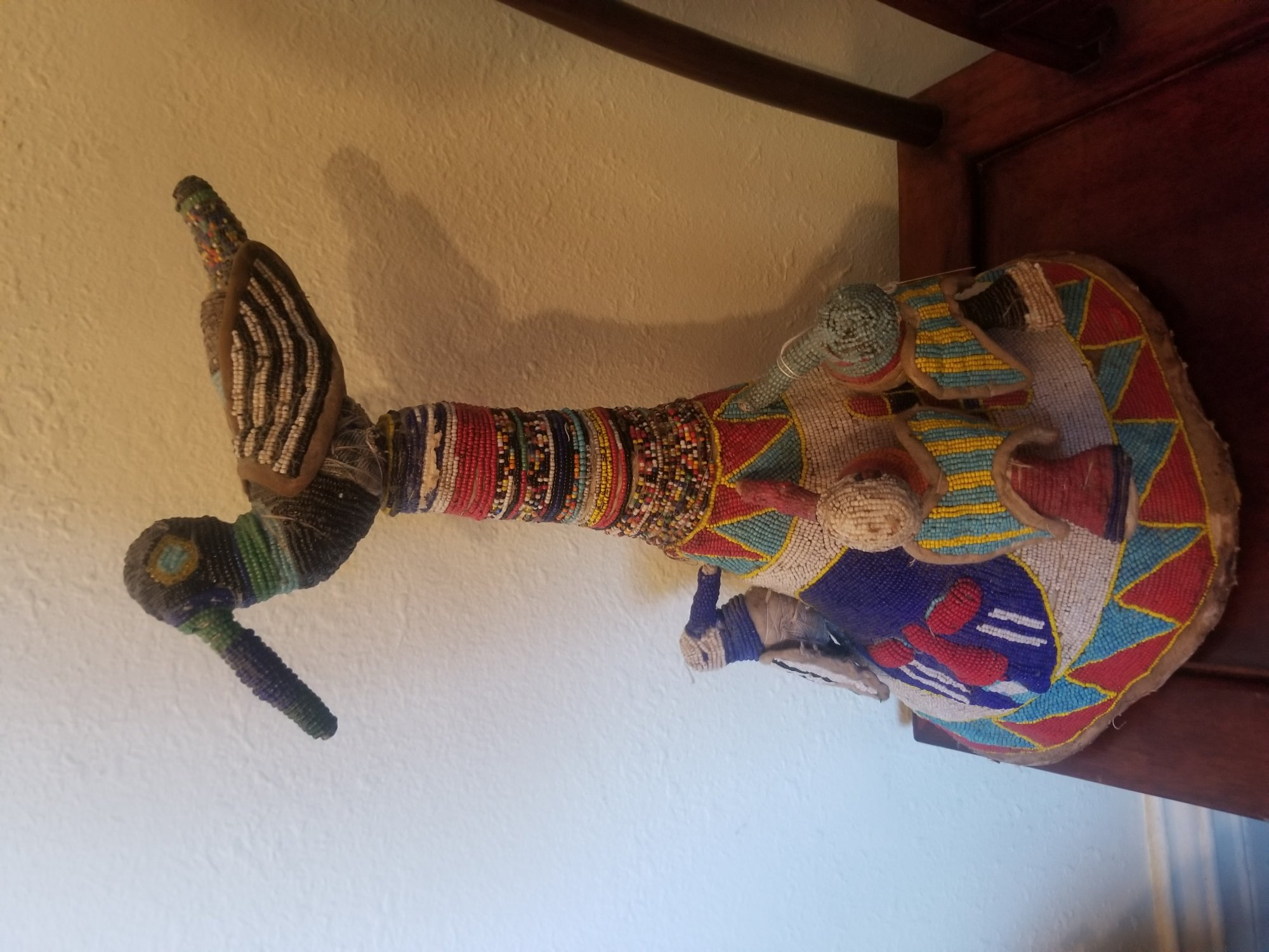 African fine beadwork hat adorned with 4 birds on the sides and one larger bird on top UUT