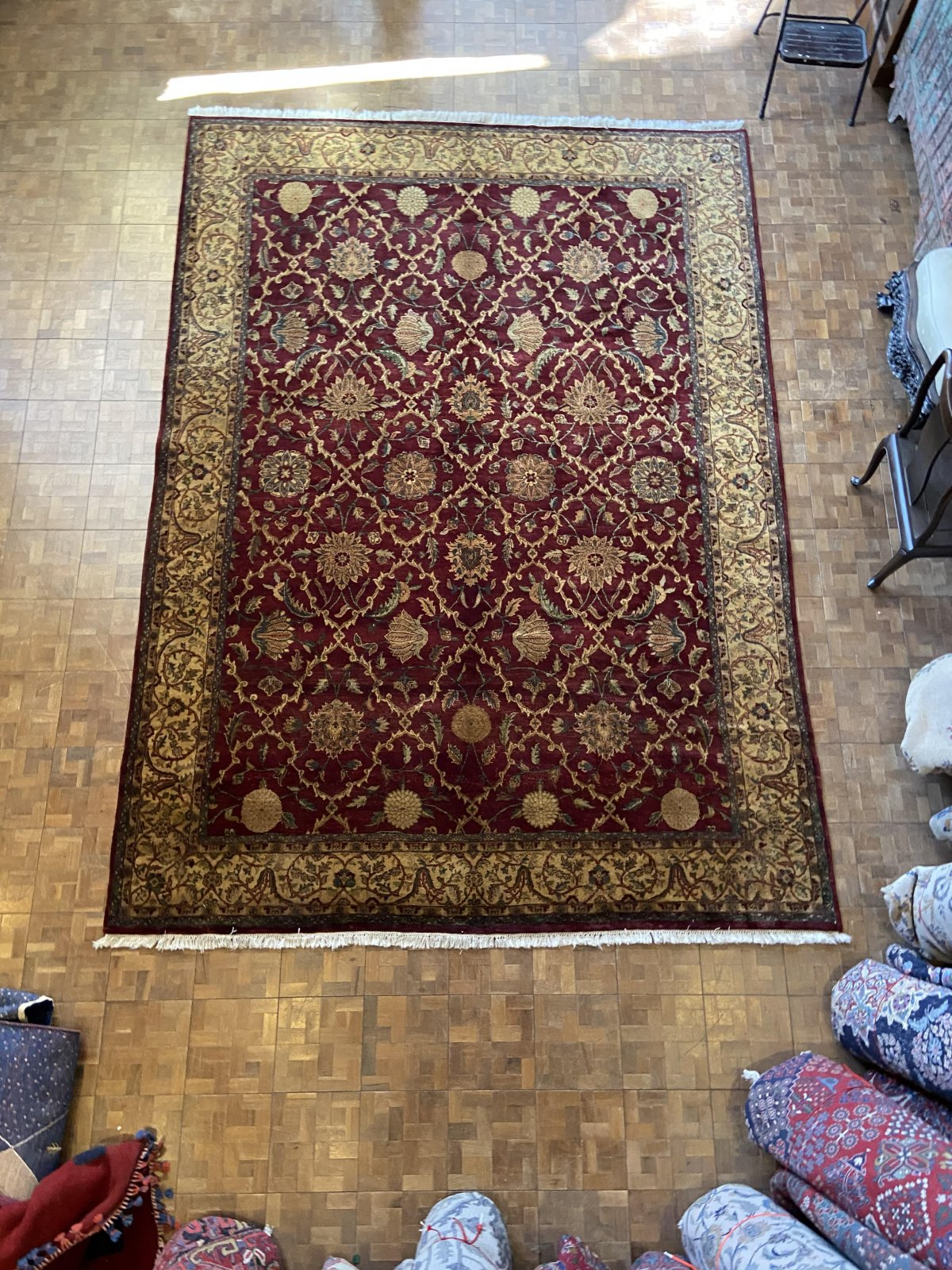 Indo Kashan, burgundy field with a cream border and multiple other colors throughout. Green, gold, beige, pink and cream SXYZ