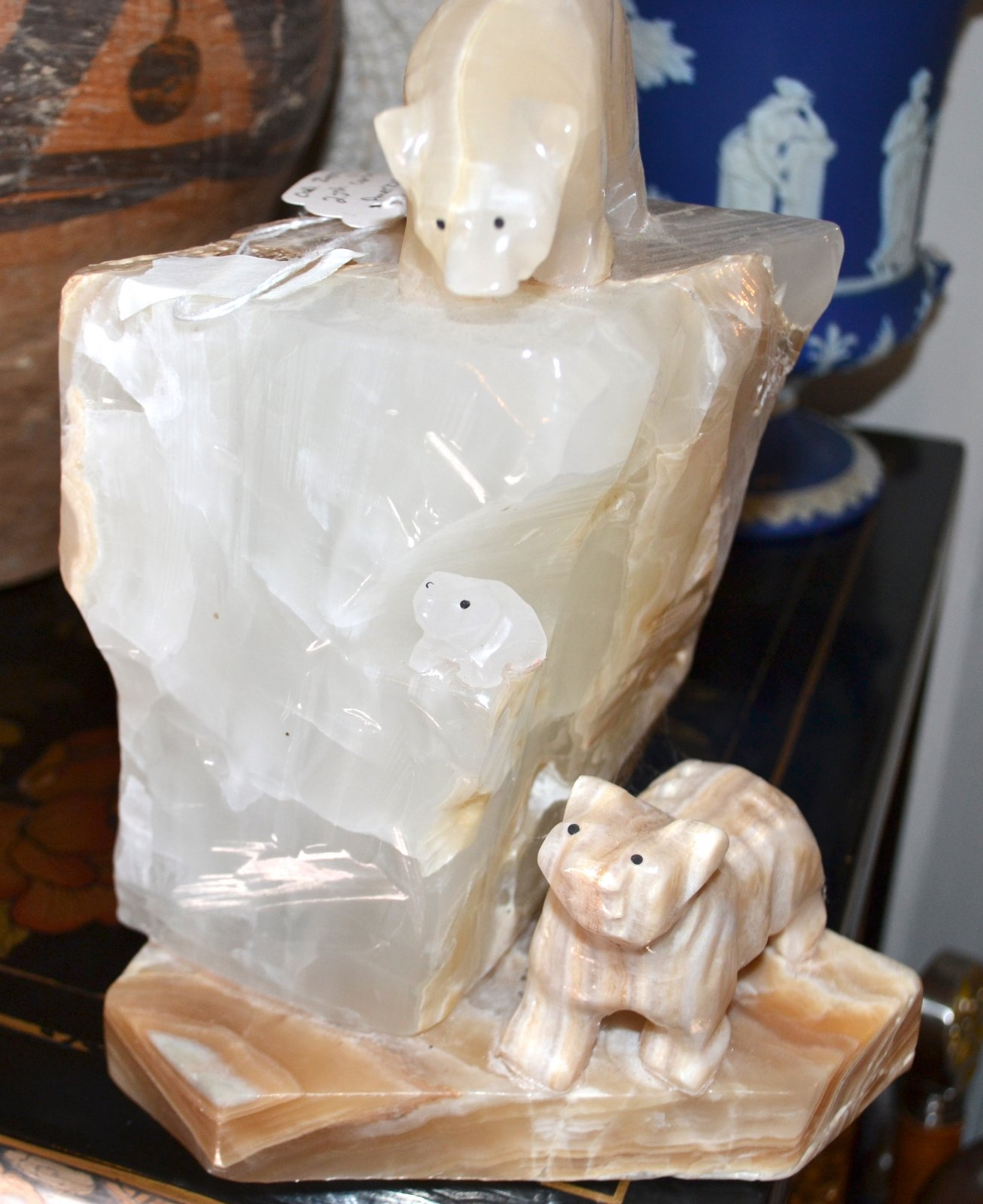 Quartz crystal lighted statue of a rock with bears