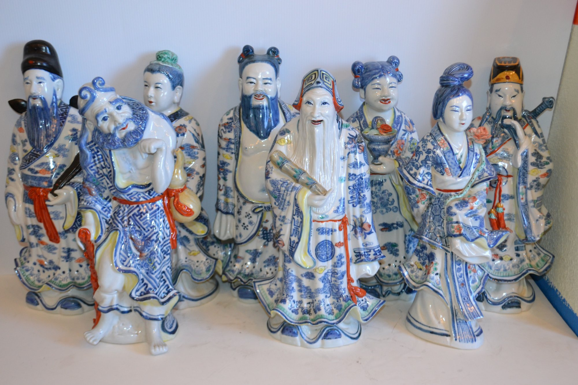Set of 8 Chinese porcelain immortal statues