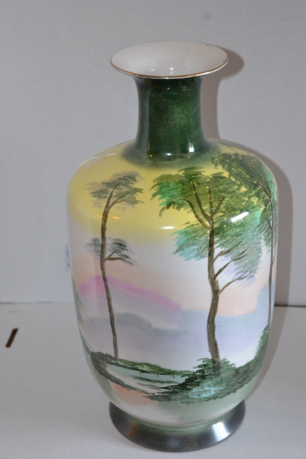 20th Century Handpainted Japanese vase w/ landscape of trees mountains and a lake. H. 16 X W. 9