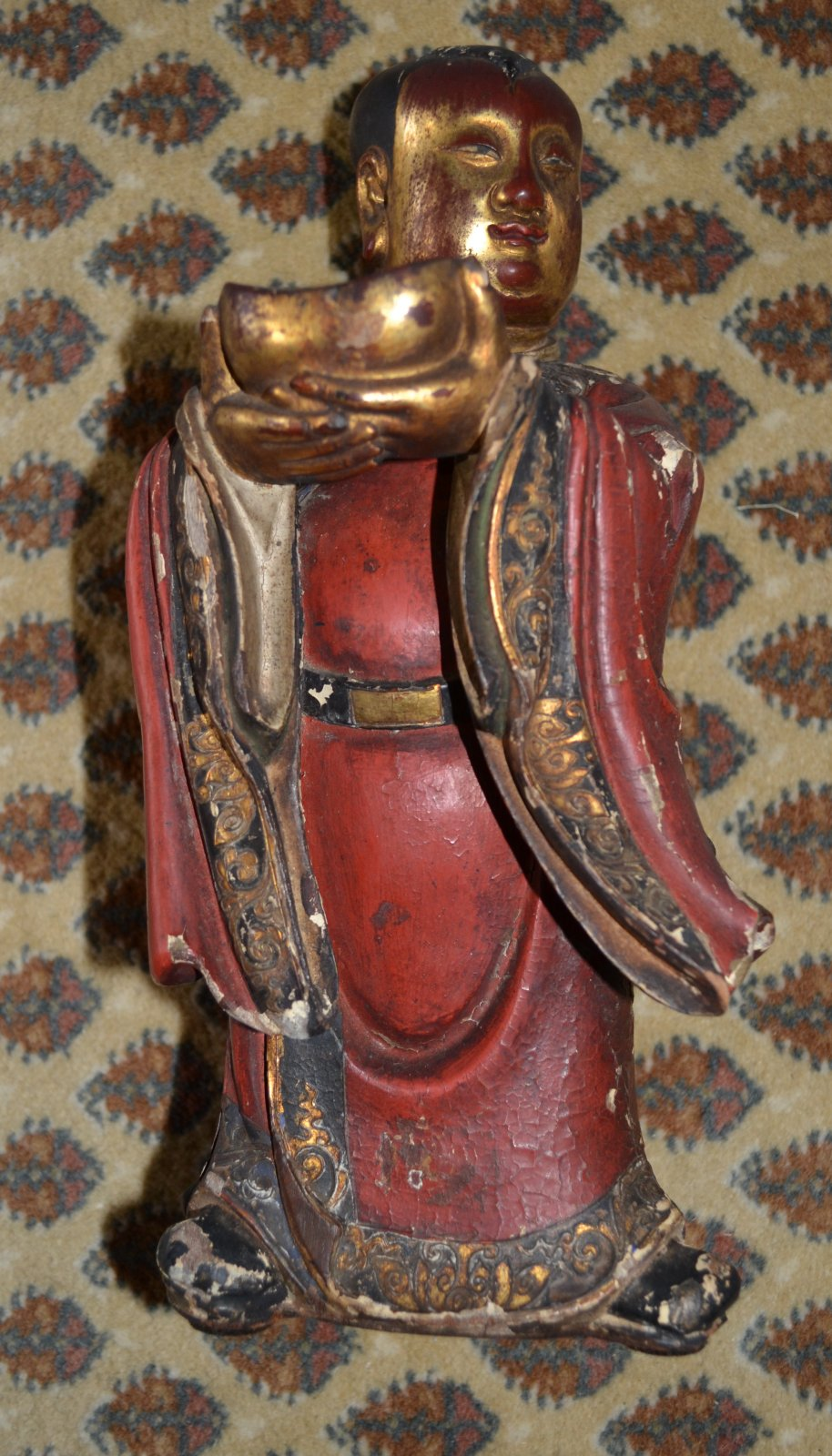 Chinese polychromed red and gold wooden figure