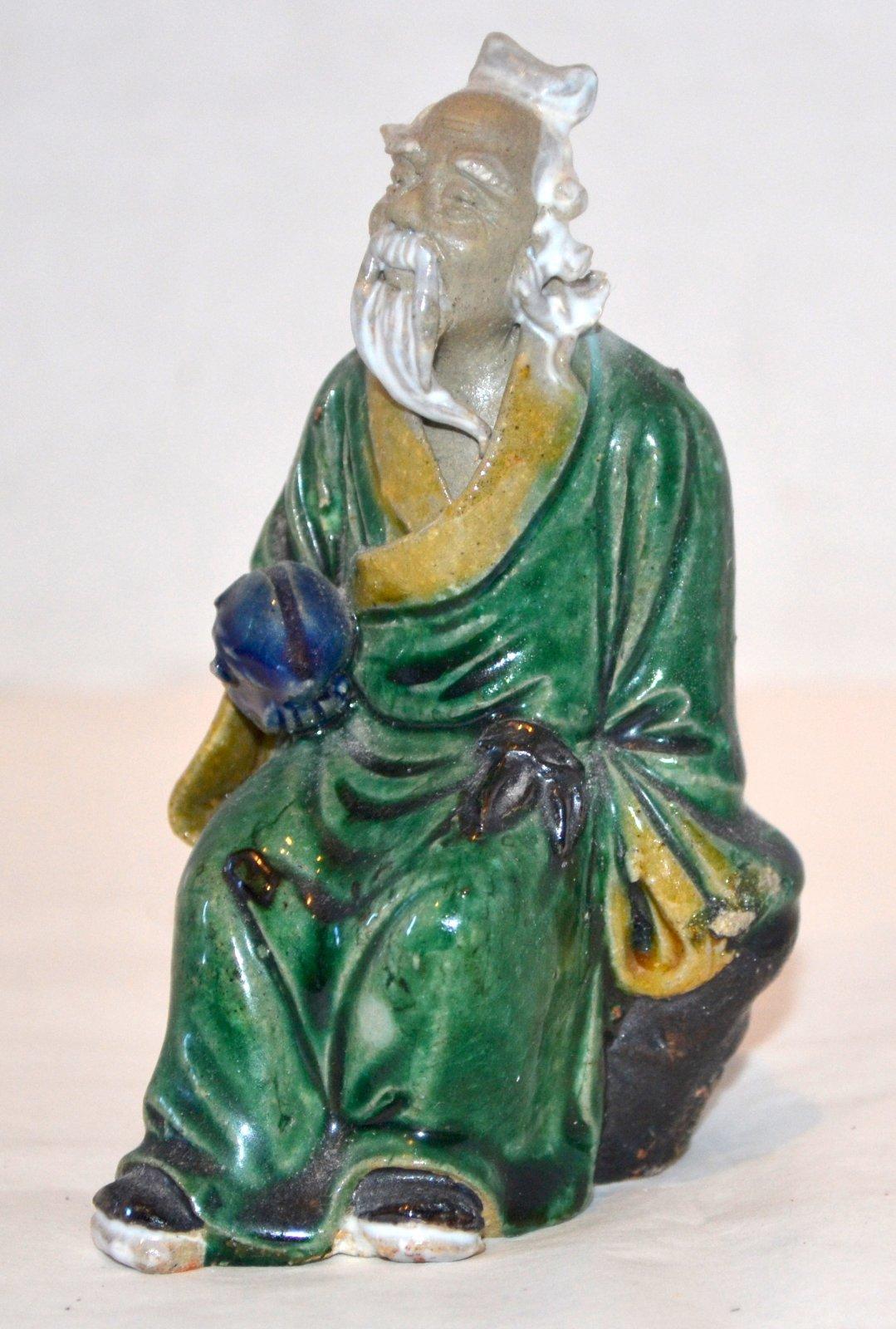 Chinese Mud Man Sitting on a rock ceramic