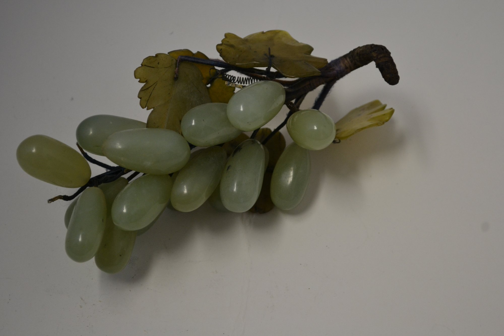 Chinese hard stone carving of a green grape cluster with leaves