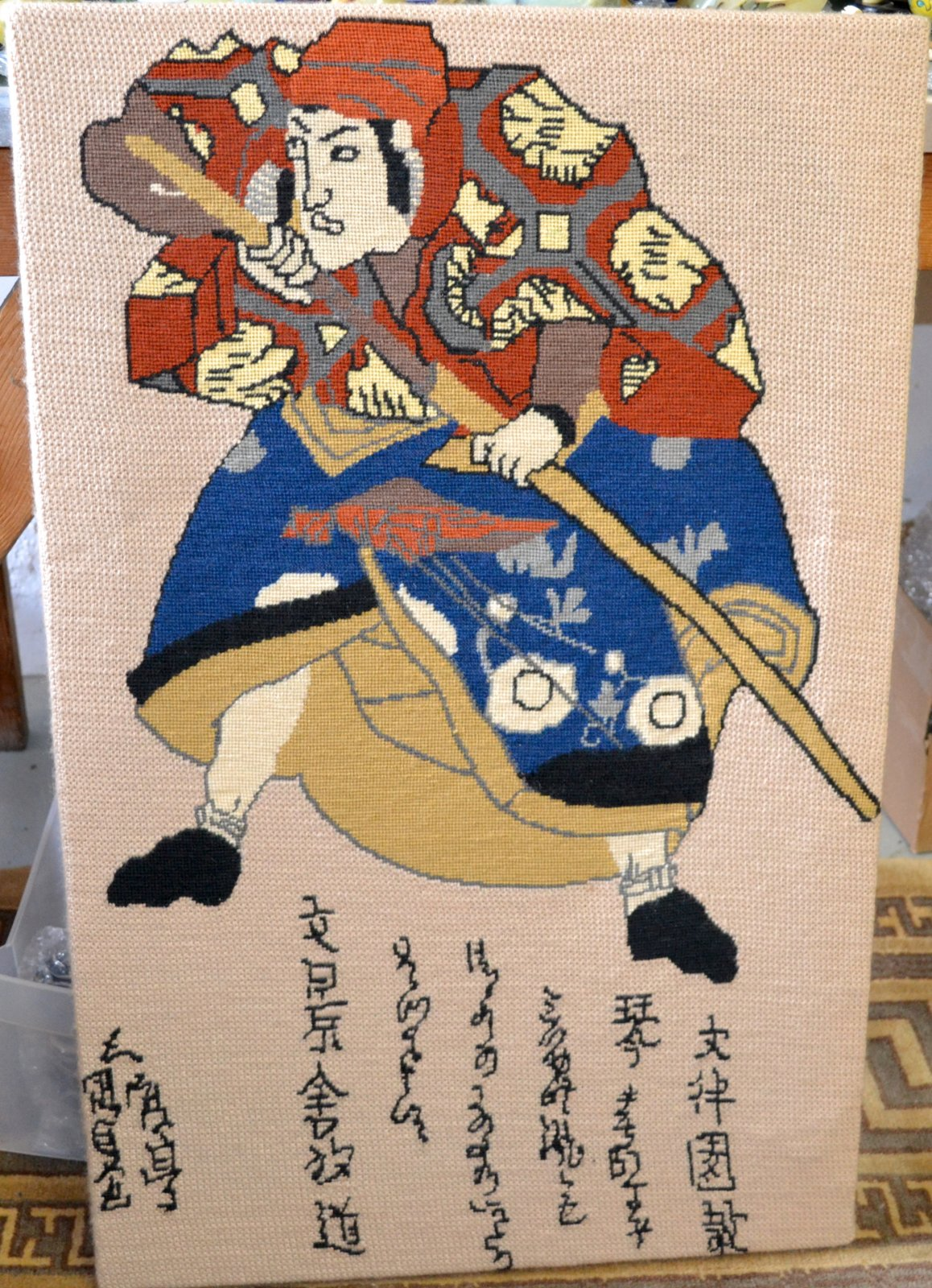 Japanese needle point of a Samurai with blue and orange outfit