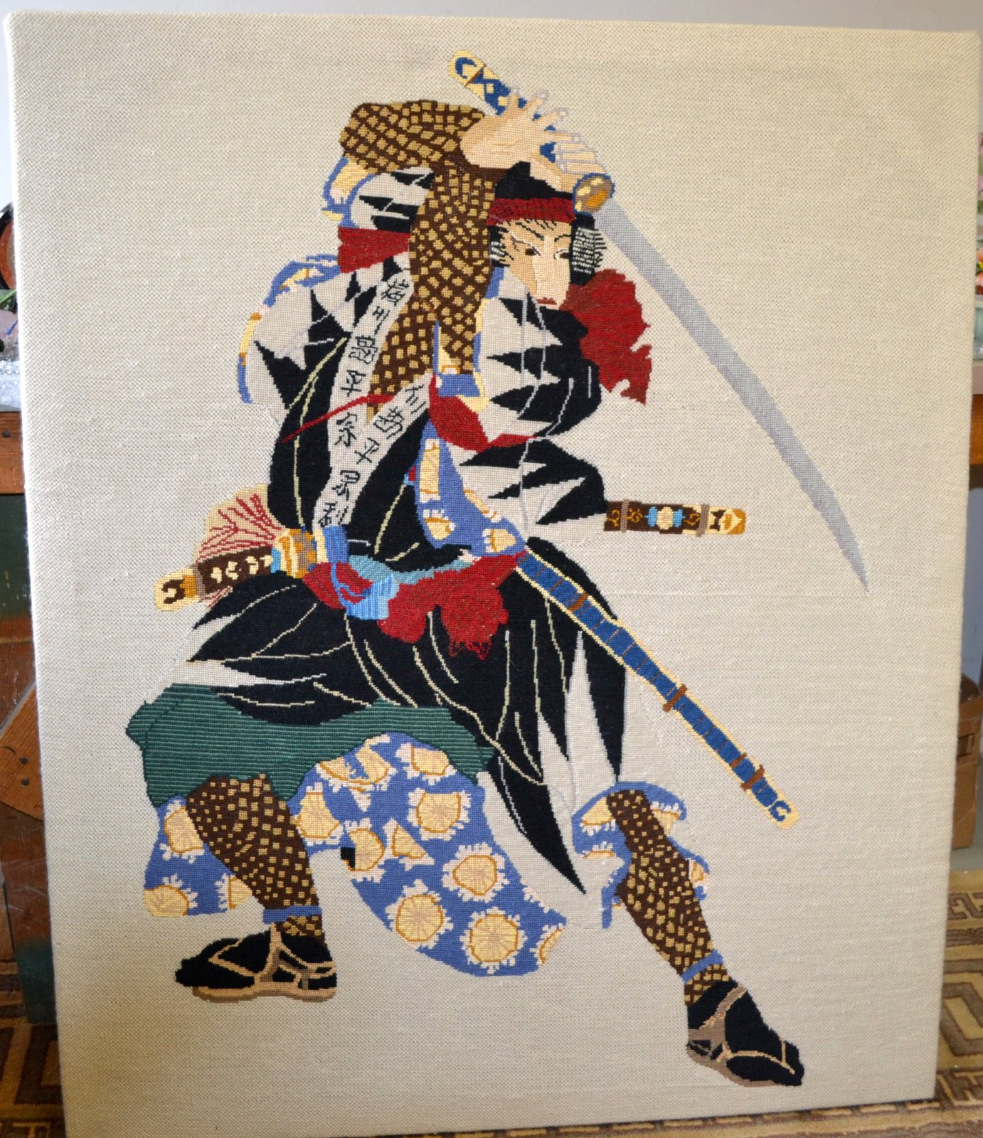 Japanese needle point of a Samurai with sword drawn