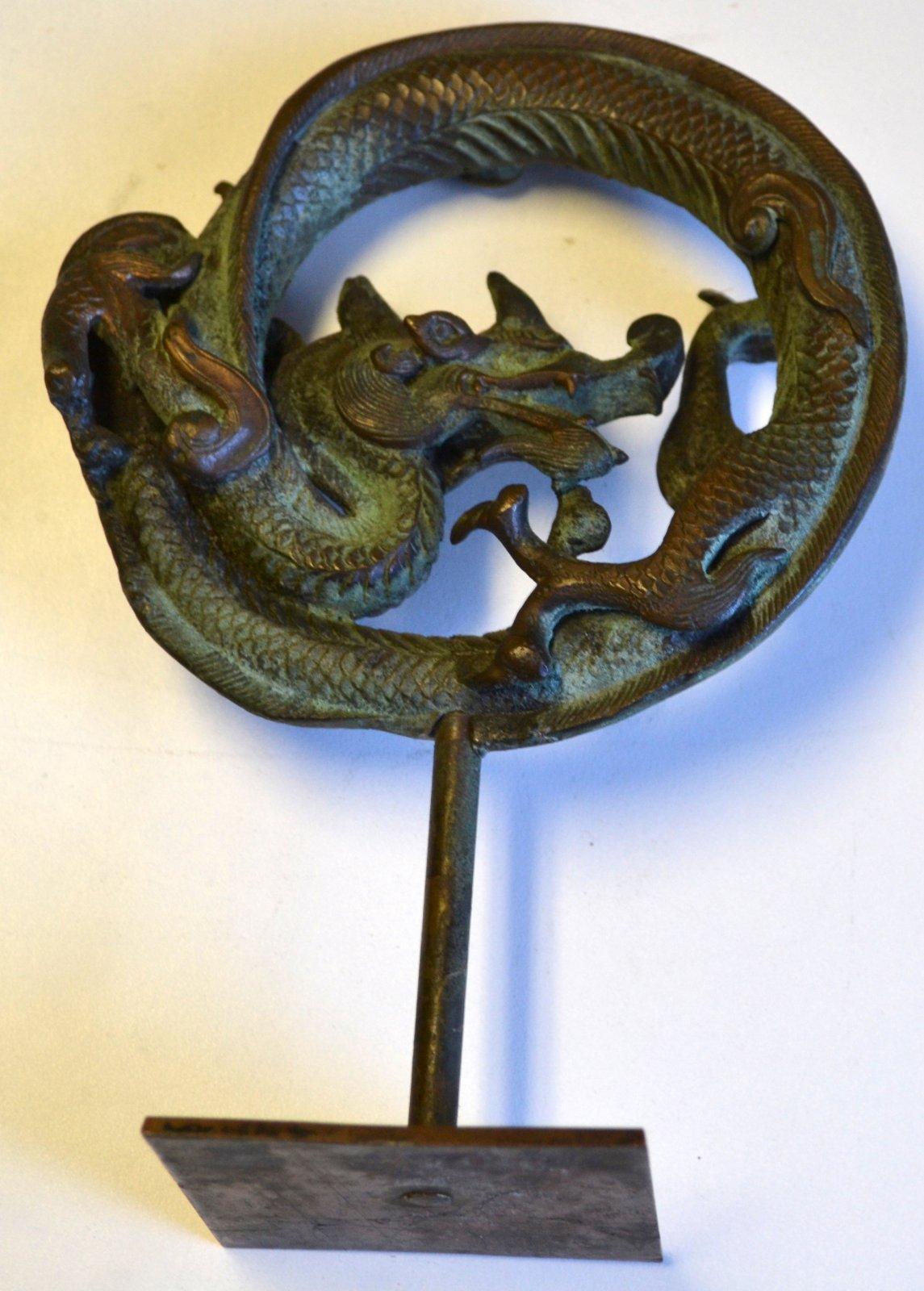 Chinese bronze circular dragon medallion on a custom stand