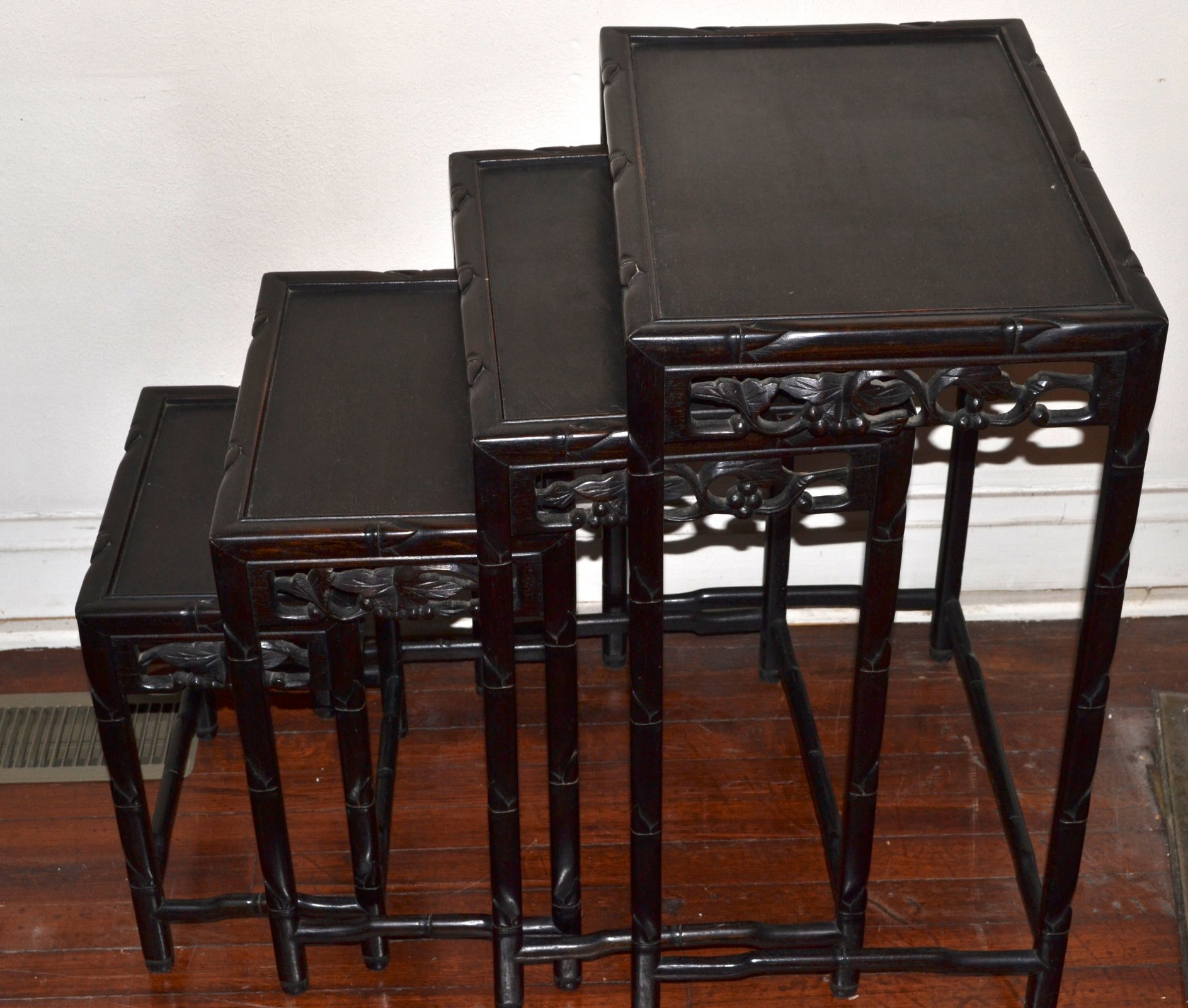 Chinese wooden hand carved nest of 4 side tables