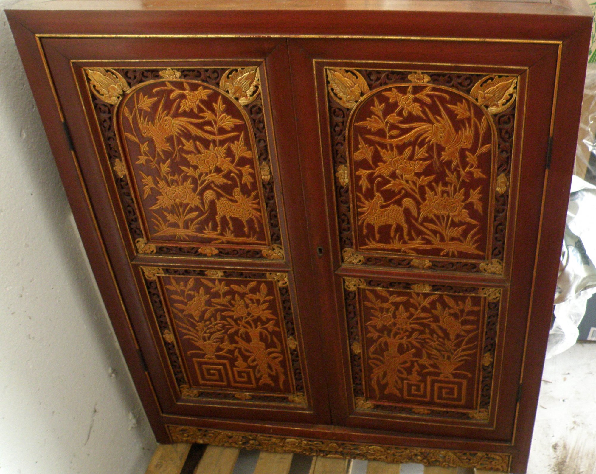 Chinese decorative wooden red lacquer carved panel cabinet