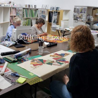 Customers sewing in Quilting Foxes classroom during Open Sew.