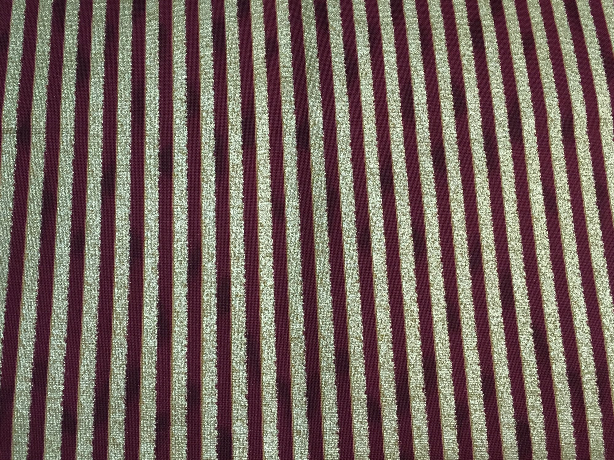 Glimmering red with gold stripes
