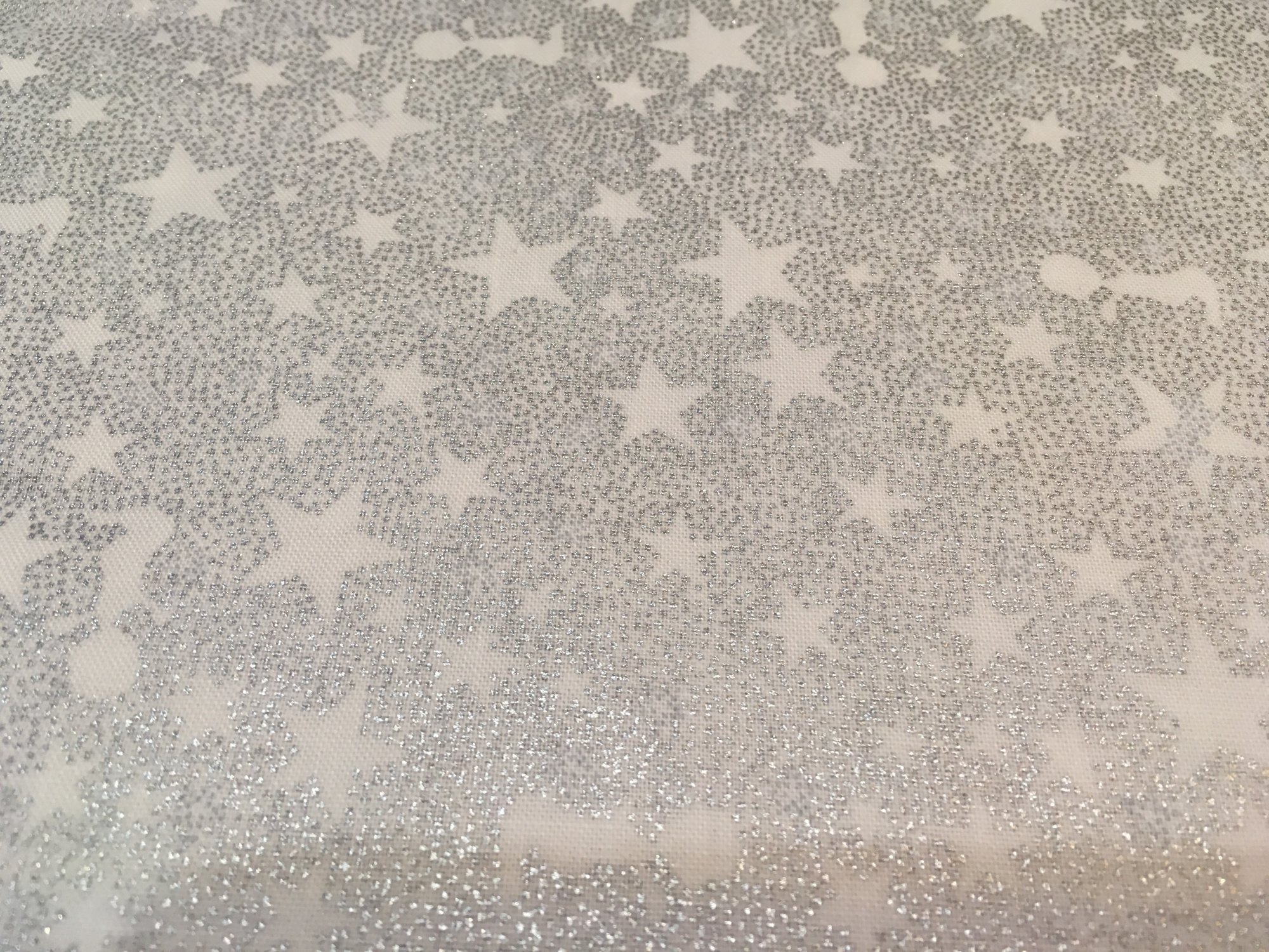 Glimmering white w/silver stars and angels