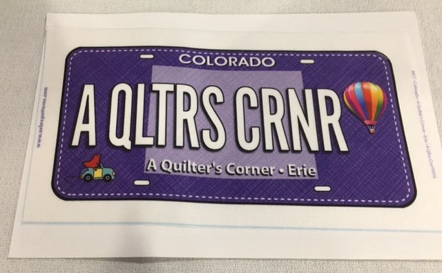A QLTRS CRNR Row by Row License FabricPlate