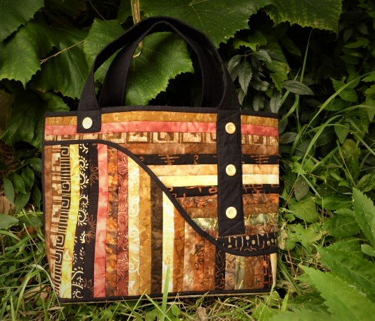 STRIPPED AND BUTTONED BAG  15 x 13 x 5
