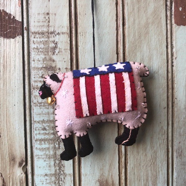 White Sheep with flag ornament