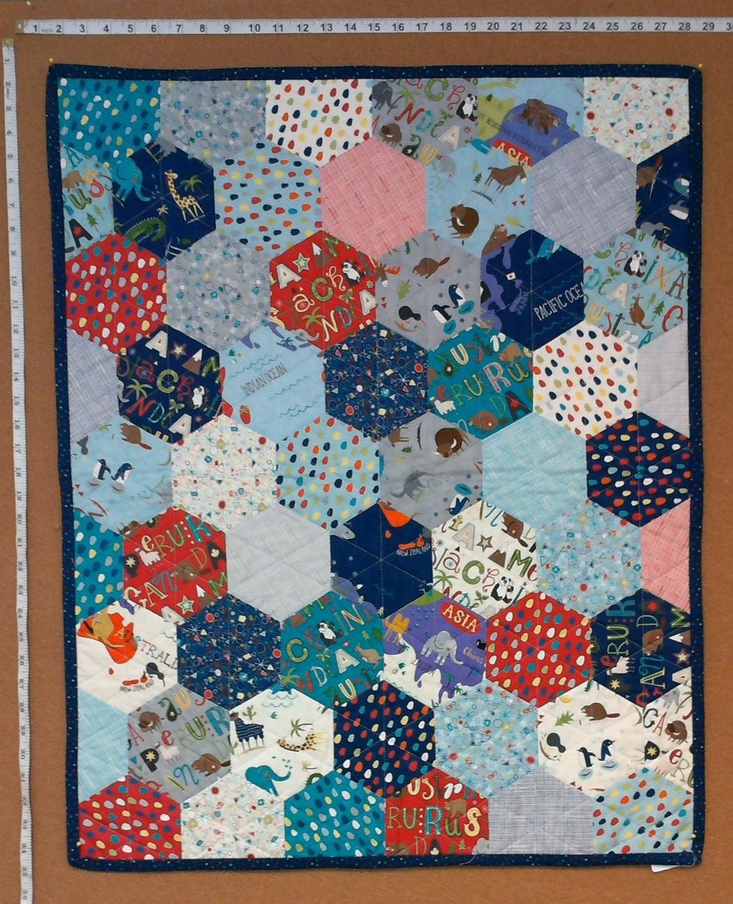 Hex Around the World Baby Quilt