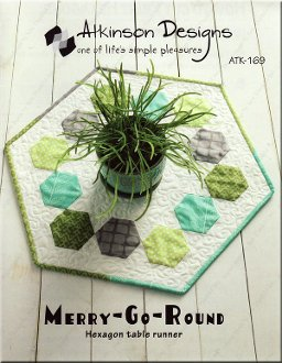Merry Go Round Hexagon Table Topper Pattern by Atkinson Designs