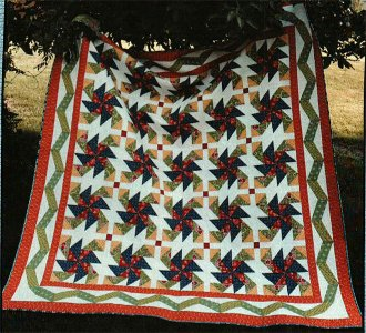 Happy Pinwheels Quilt Pattern by Quilted Garden Designs
