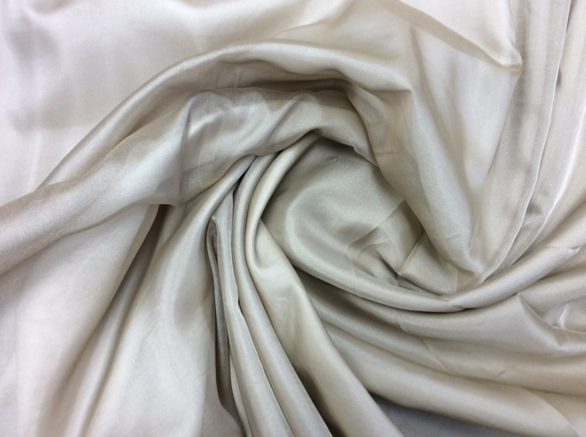 CAR1802. Polyester Wide Width Sheer. 118 Wide. Light Taupe