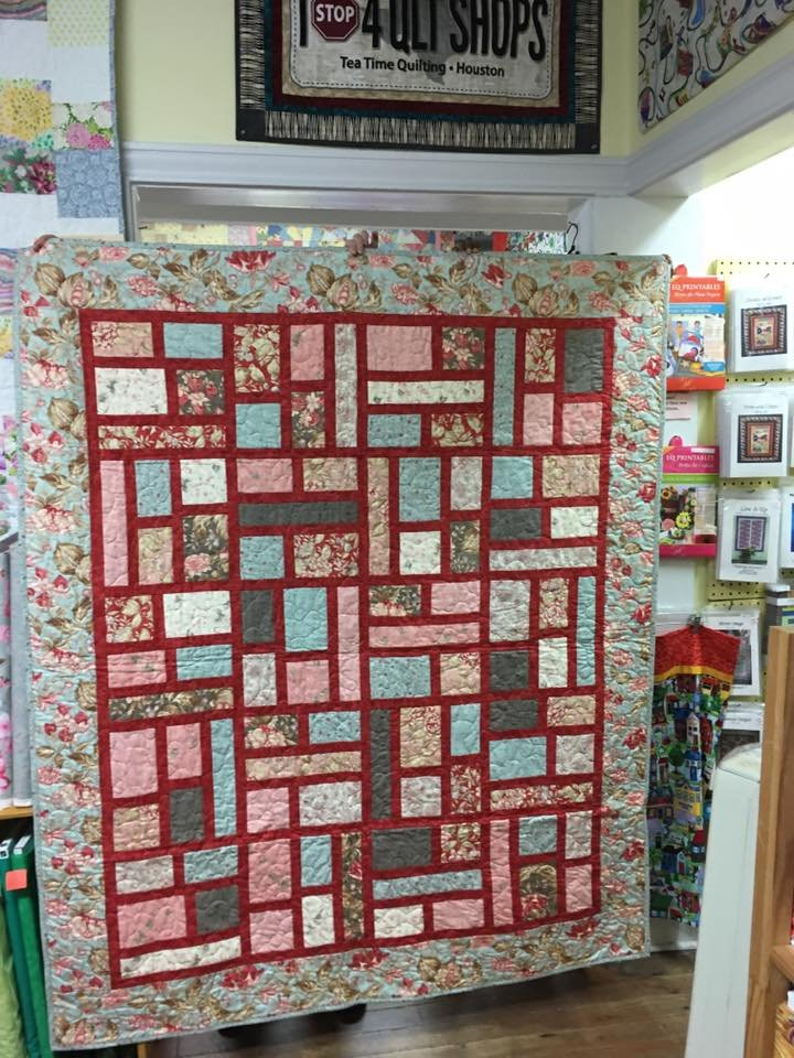 County Lines Light Blue and Red Quilt