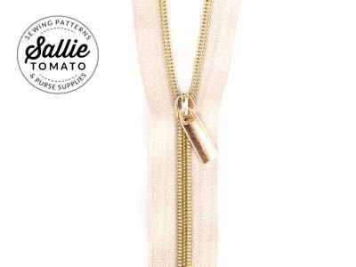 Sallie Tomato Zippers by the Yard (Beige Tape with Lt Gold Teeth)