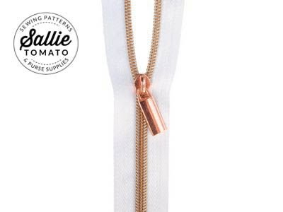 Sallie Tomato Zippers by the Yard (White Tape with Copper Teeth)
