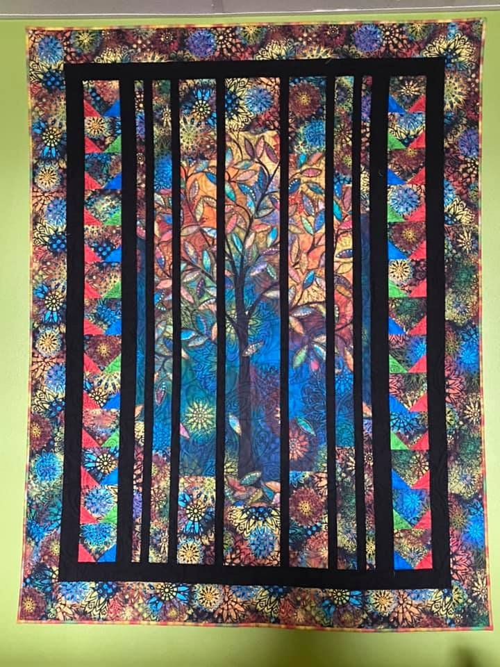 Light In The Forest fabric quilt kit. Fabrics by Sue Penn for Free Spirit