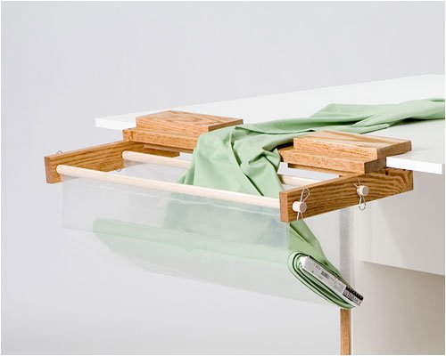 Tracey's Tables Fabric Cradle holds yard goods for ease in cutting lenths of fabric