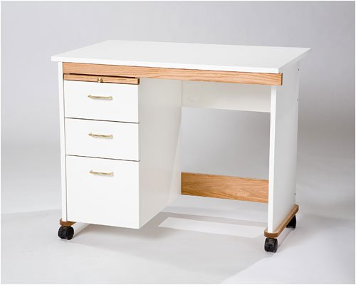 Tracey's Tables 3 drawer Go Sew cart will make an L-shaped work area when paired with other cabinets. Includes drawers and bread board.