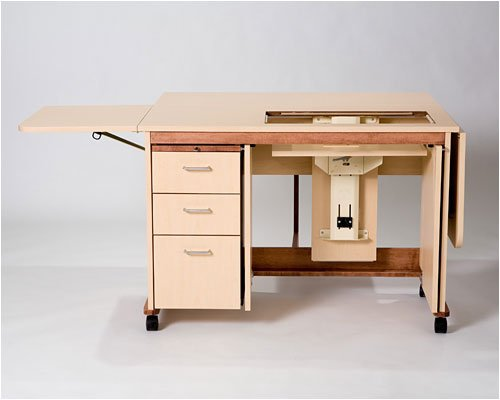 Tracey's Tables Standard Sewing Cabinet/table shown in Maple with 3 drawers, breadboard, side leafs, pnuematic lift and flipper doors