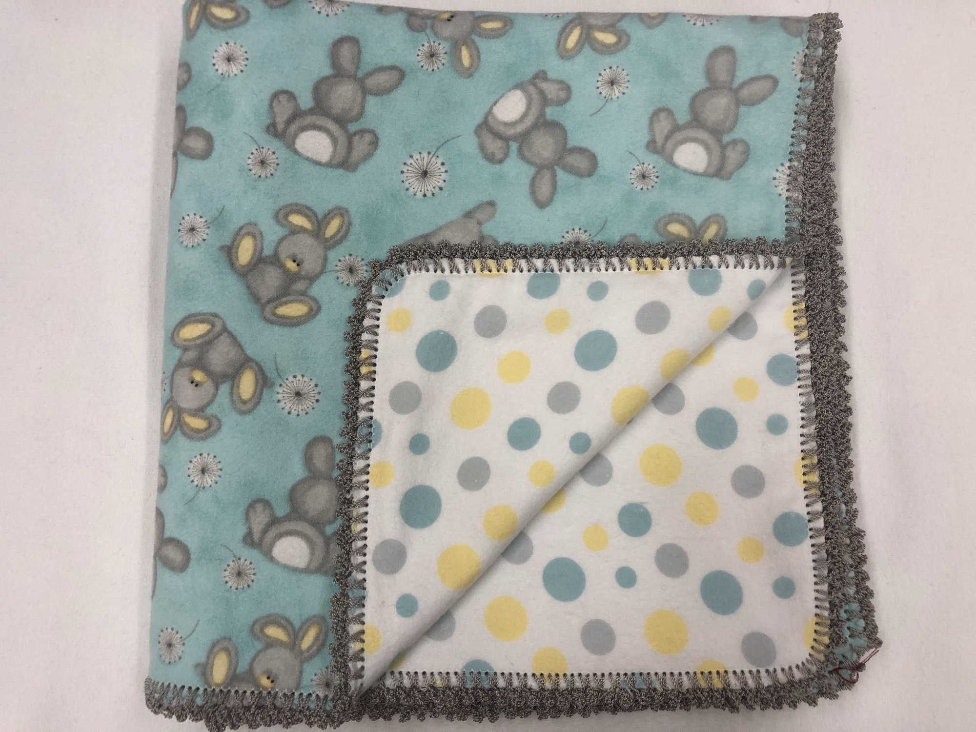 Bunnies with dandelion on blue/Blue and yellow dots on white background crocheted blanket