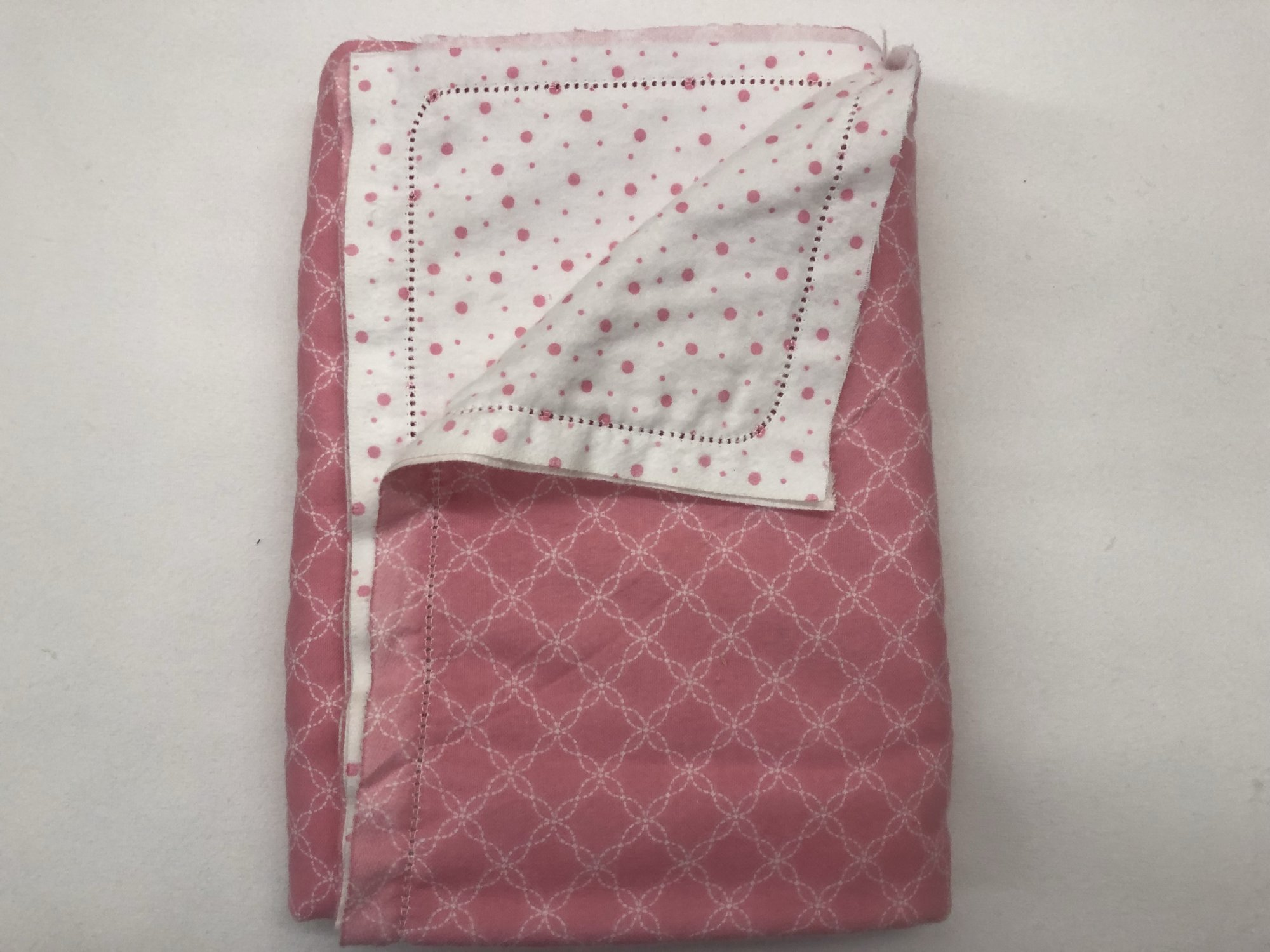 Pink with white flowers and white with pink polka dots