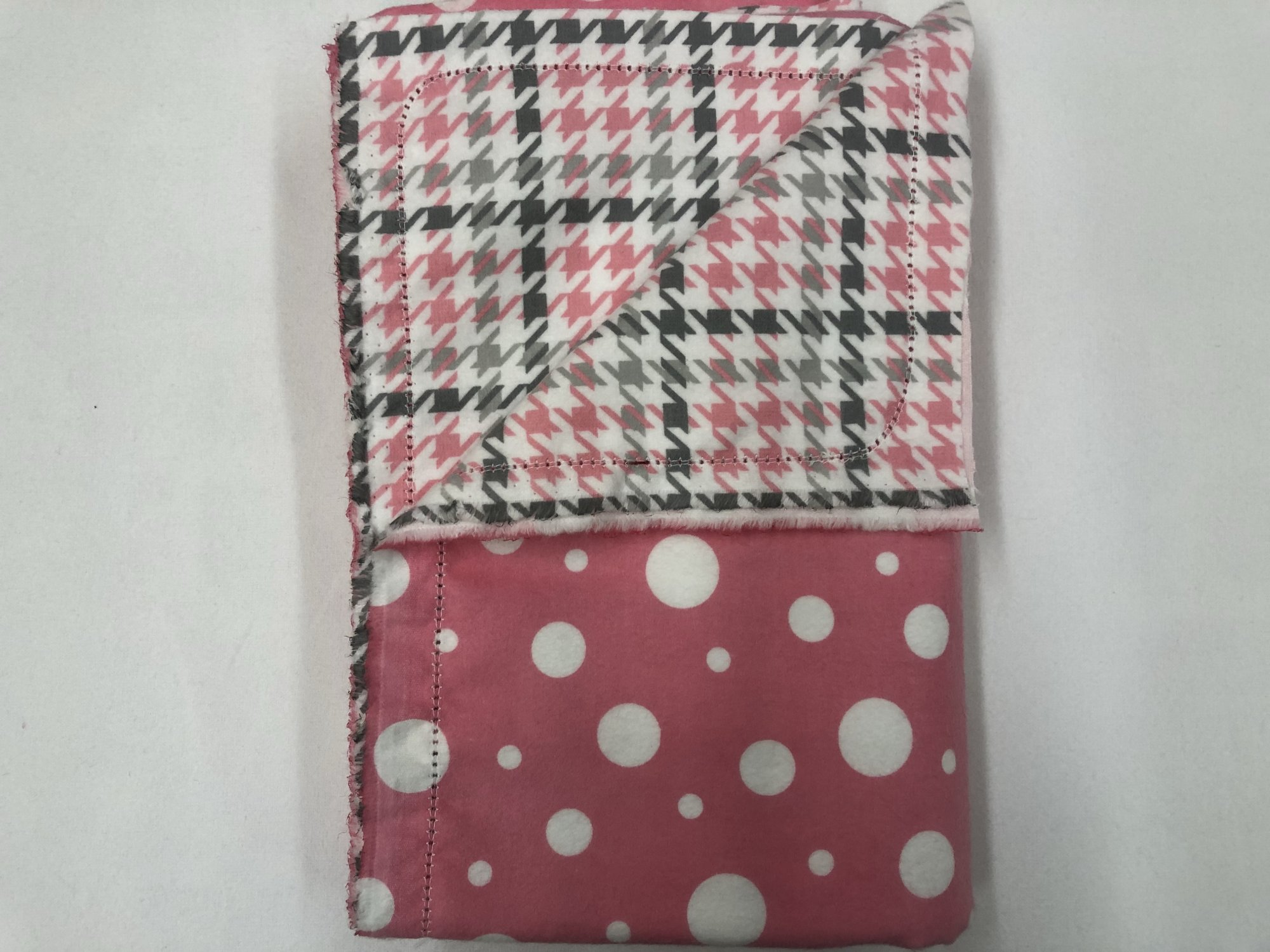 Large white polkadots on pink background with grey/pink houndstooth on white