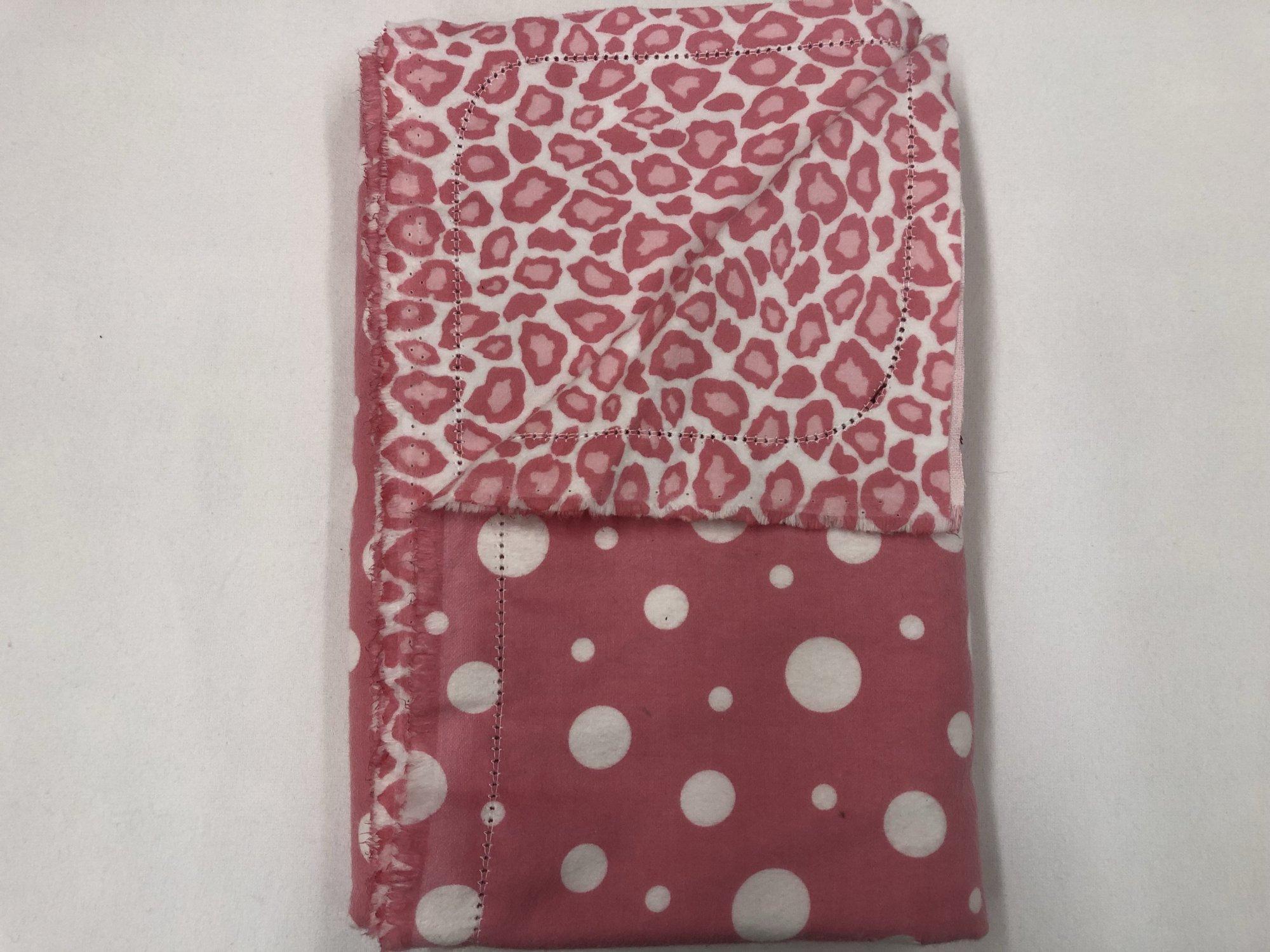Large white polkadots on pink background/pink cheetah pattern on white background