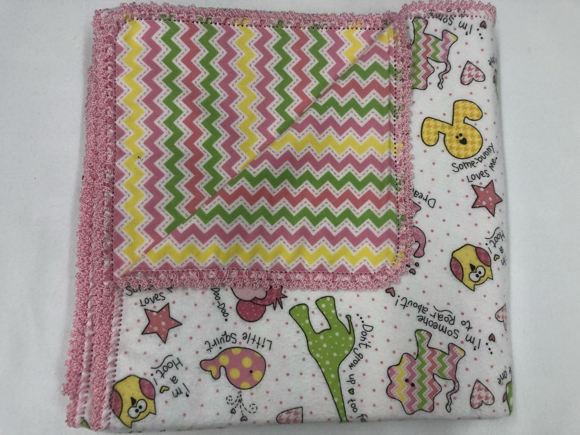 Multi-color animals with words and dots on white background/Pink,yellow, and green chevron crocheted blanket