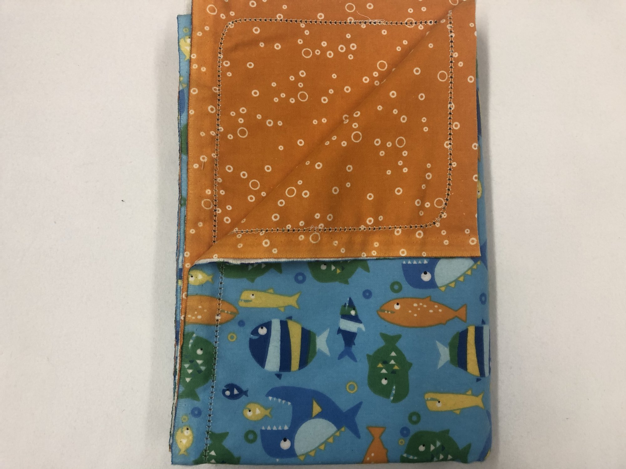 Multi-color fishes on blue background/White bubbles on orange background