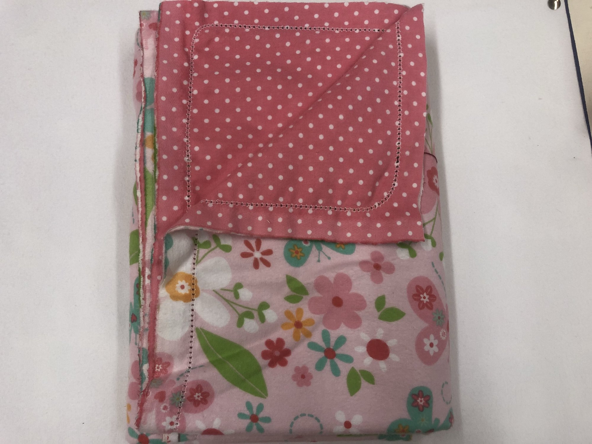 Multi-color flowers and butterflys on pink background/White dots on pink background