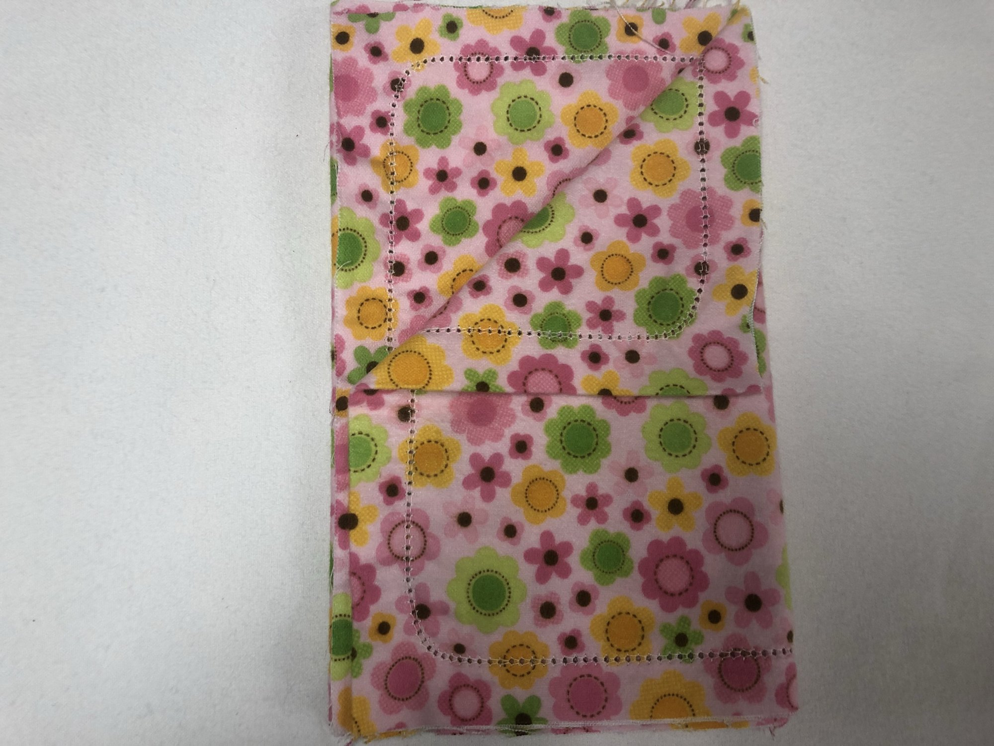 Multi-color flowers on pink background burp