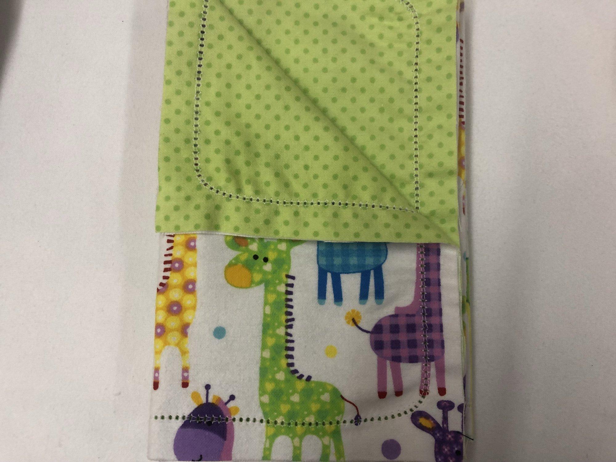 Multi-color Giraffe's on white background/Dark green dots on light green background burp