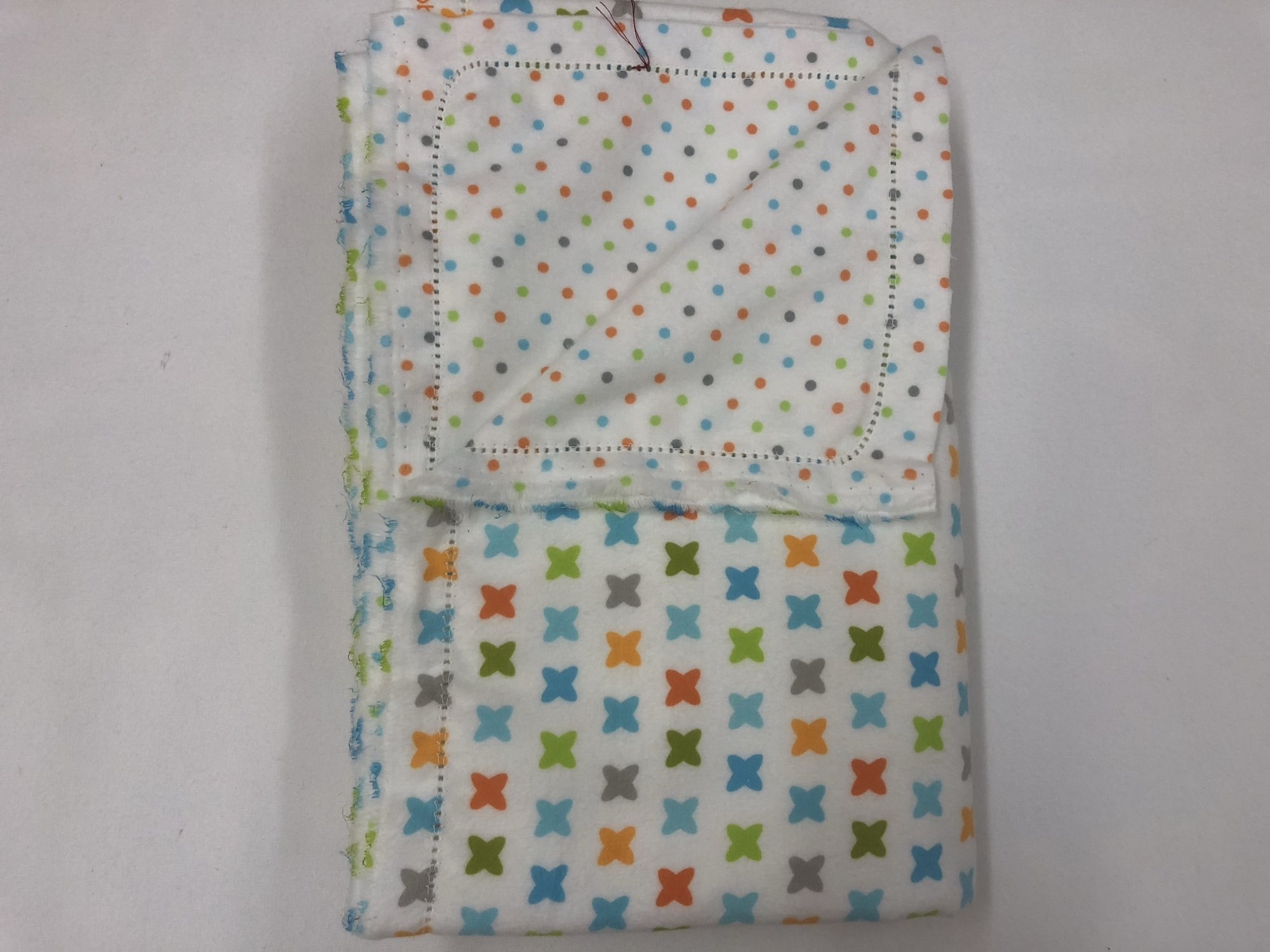 Multi-color 'X's on white background/multi-color dots on white fabric