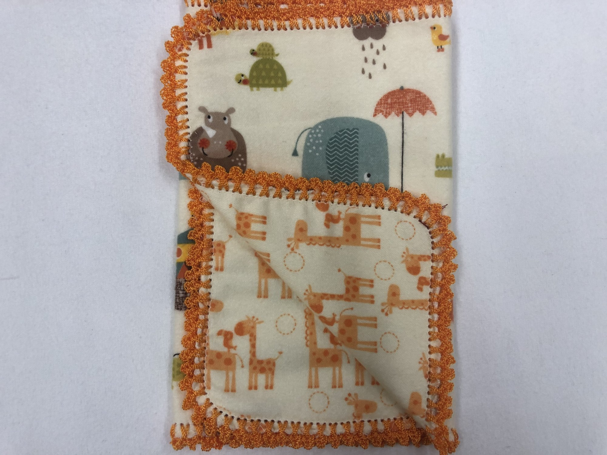 Noah's ark on cream background/Orange giraffe's on cream background crocheted burp cloth