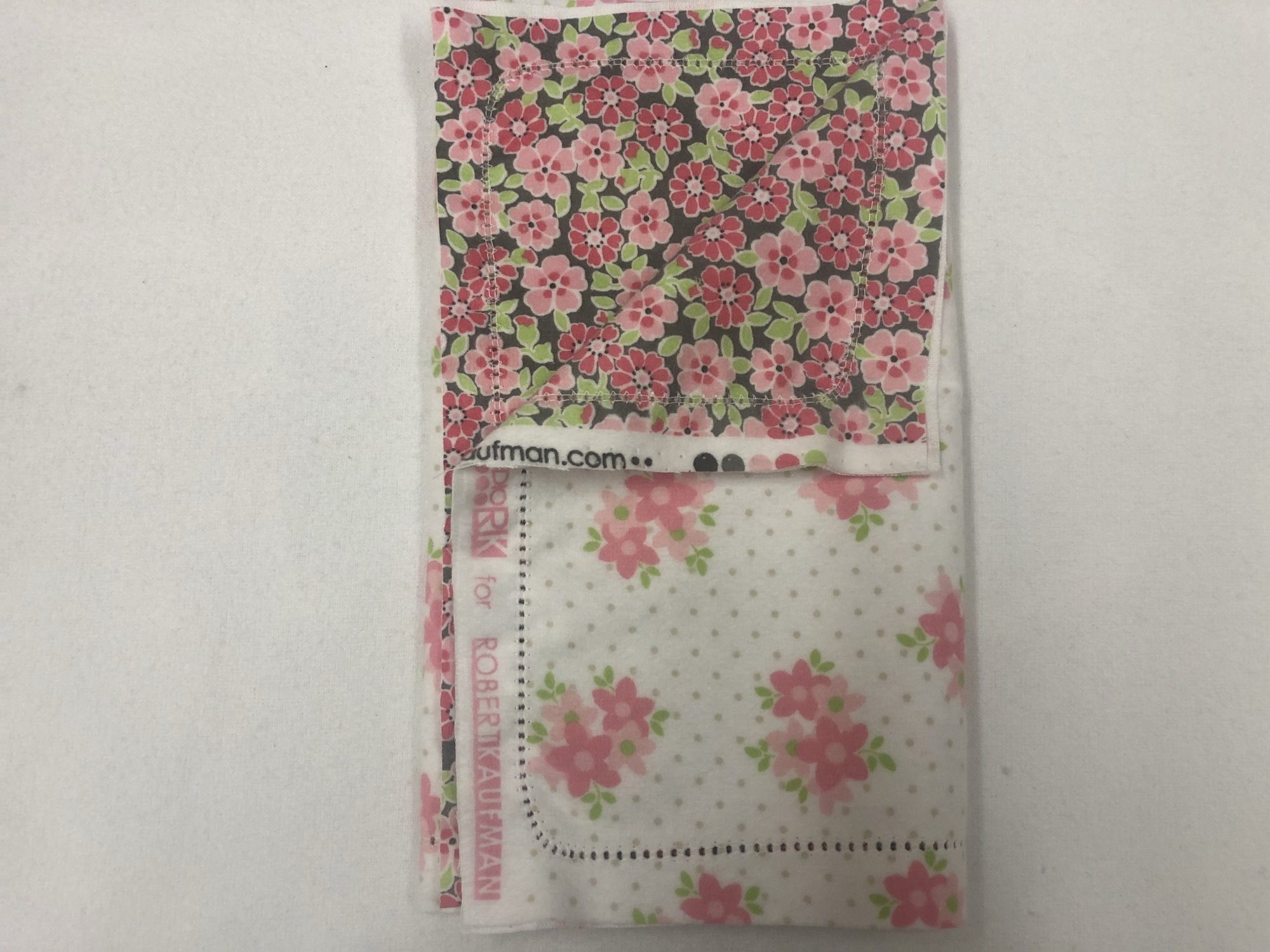 pink flowers and dots of white background/pink flowers and leaves on grey background burp