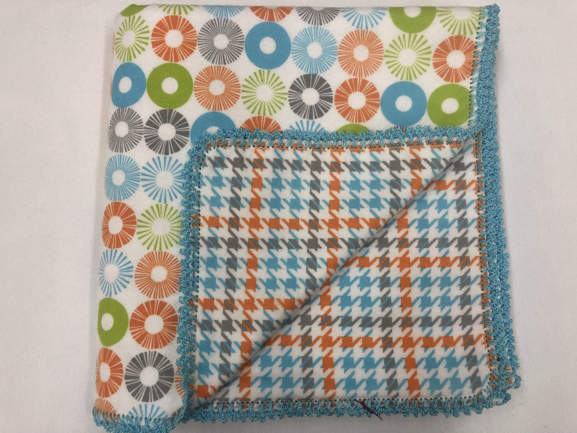 Teal, orange, green, and grey circles on white background/Teal, grey,  and orange houndstooth crocheted blanket