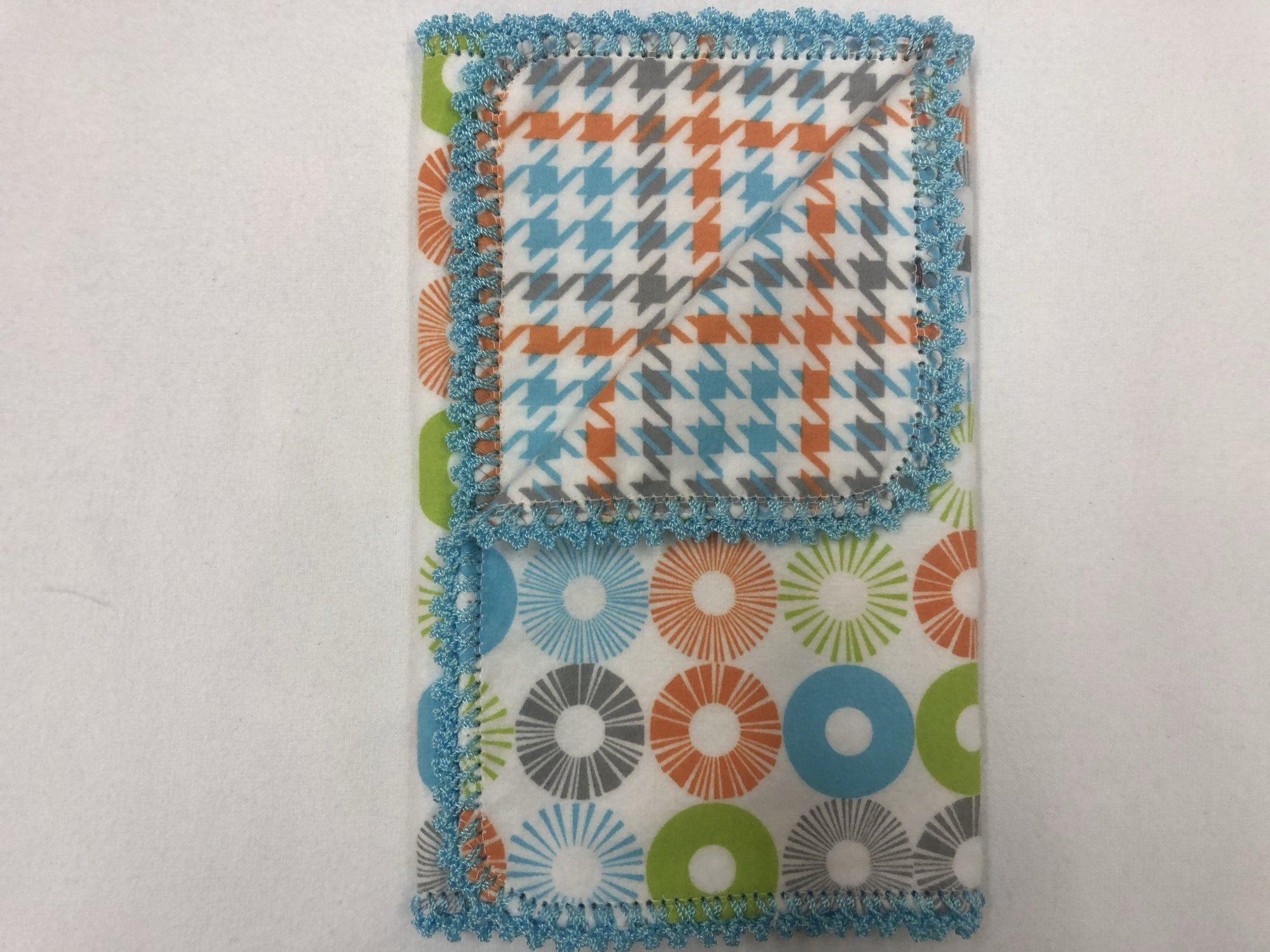 Teal, orange, green, and grey circles on white background/Teal, grey,  and orange houndstooth crocheted burp cloth
